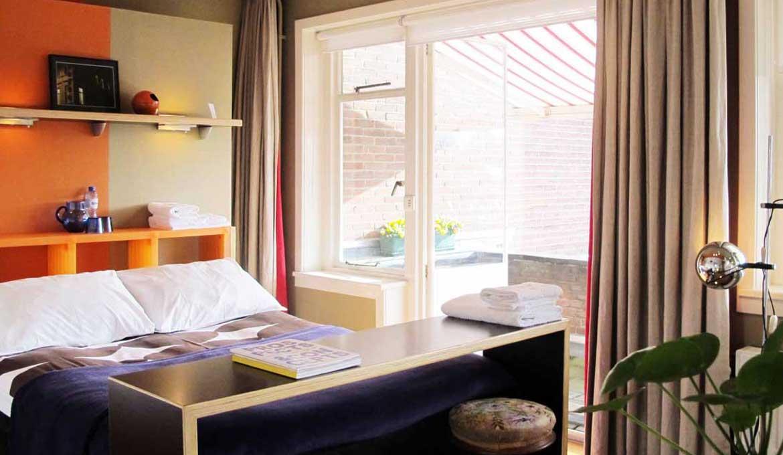 Orange Submarine room in Gust van Dijk. BnB and SEA Foundation, Tilburg, the Netherlands